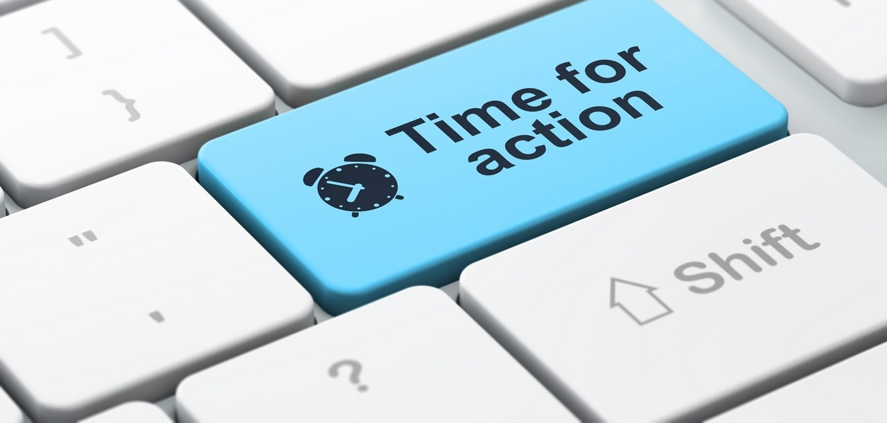 "cropped image of a keyboard with a blue button that has an alarm clock icon and the words ""Time for action"""